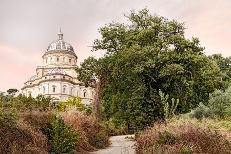 the renaissance church Santa Maria della Consolazione in Todi, Umbria, Italy - view from the countryside of the famous catholic pilgrimage cathedral  photo