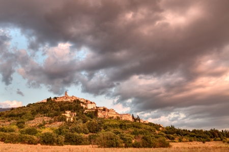landscape at sunset of the town on the hill Trevi, Umbria, Italy, under a dramatic cloudy sky photo