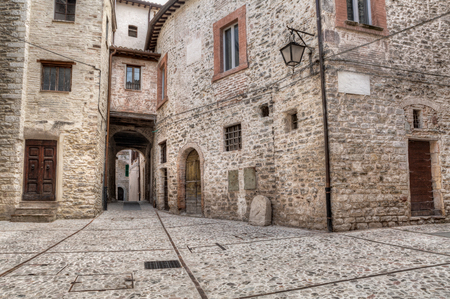 little town: a picturesque little square of the italian medieval town - antique narrow alley in Spoleto, Umbria, Italy