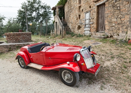 bevagna: a british roadster car Armstrong Siddeley at the classic car rally during the festival Festa di fine Estate on September 8, 2013 in Bevagna, PG, Italy