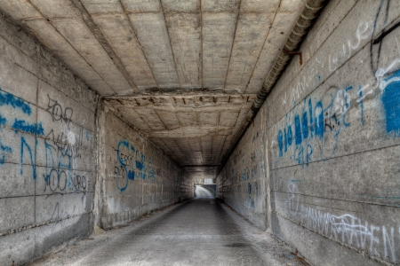 decadent: dark narrow gallery - dirty decadent underpass in the old town