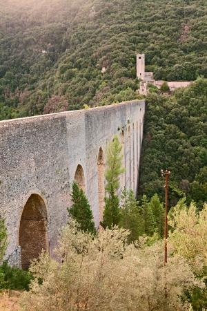 view of the Ponte delle Torri, an antique bridge aqueduct  13th century  in Spoleto,Umbria, Italy photo