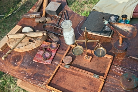 jeweler: ancient work table with old tools of the artisan jeweler - antique goldsmith workshop