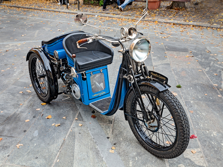 three wheeler: a French three wheeler motorcycle Monet Goyon (1927) at rally of ancient car and motorbike, during the festival Borghi in festa on October 20, 2013 in Forli, Italy Editorial