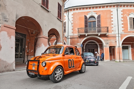 tuned: tuned vintage car Fiat 500 runs along the city during the rally Meeting Fiat 500 e auto depoca on November 10, 2013 in Bagnacavallo, RA, Italy Editorial