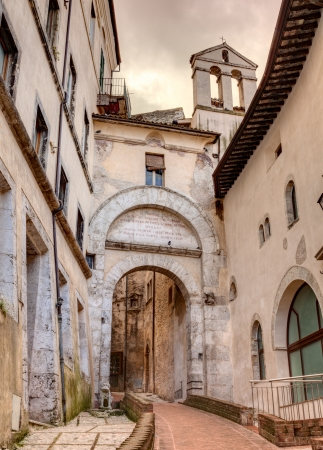 narrow: the ancient city gate  Porta Fuga  in the medieval town Spoleto, Umbria , Italy