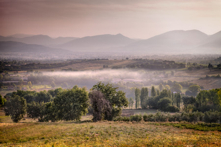 bevagna: sunrise on the hills of Bevagna, Umbria, Italy - italian landscape at dawn with fog in the valley Stock Photo