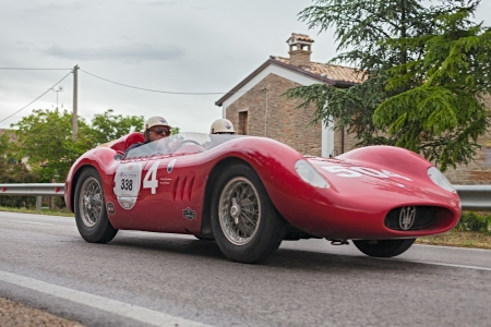 mille: vintage racing car Maserati Maserati 200 SI (1957)  in rally Mille Miglia 2013, the famous italian historical race (1927-1957) on May 17, 2013 in Ravenna, Italy   Editorial