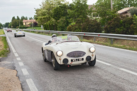vintage sports car Austin Healey 100 S (1955) runs in rally Mille Miglia 2013, the famous italian historical race (1927-1957) on May 17, 2013 in Ravenna, Italy