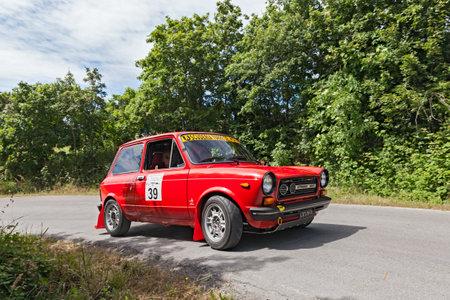 italian car: a vintage italian car Autobianchi A 112 Abarth (1977) runs in rally VII Coppa cittá di Meldola on June 2, 2013 in Meldola (FC) Italy