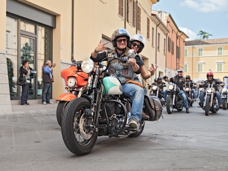 blissfulness: happy bikers does the typical greeting riding Harley Davidson at motorcycle rally Sangiovese tour by Ravenna Chapter on September 22, 2013 in Lugo (RA) Italy  Editorial