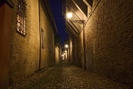 narrow dark alley in the Italian old town - street at night in the city of Italy   photo