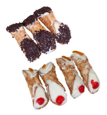 cannoli pastry: italian cannoli, a traditional sicilian dessert made with fried pastry dough filled with creamy, ricotta, almond, chocolate, fruit, candy - isolated