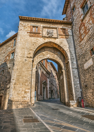 catena: the ancient city gate Porta Catena in the medieval town Todi, Umbria , Italy