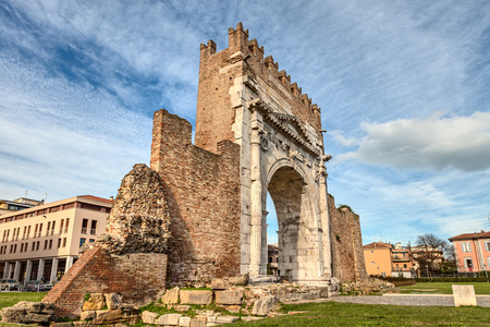 intact: Arch of Augustus  in Rimini, Italy - ancient romanesque gate of the city - historical italian landmark, the most ancient roman arch that still stands intact