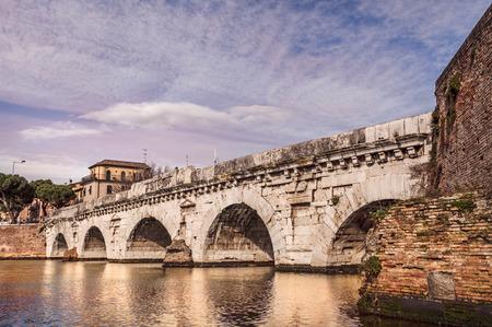 emilia romagna: the ancient roman arch bridge of Tiberius in Rimini, historical landmark of Italy