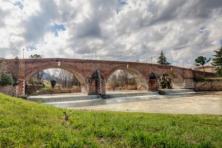 savio: the old arch bridge  Ponte Vecchio  over the Savio river in Cesena, Emilia Romagna, Italy