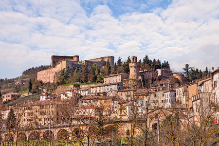 cityscape of the little town Castrocaro Terme, Emilia Romagna, Italy, with the ancient castle above photo
