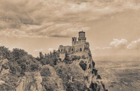 emilia romagna: Republic of San Marino landscape: the ancient fortress Guaita on a peak of Monte Titano - image filtered to simulate a vintage postcard