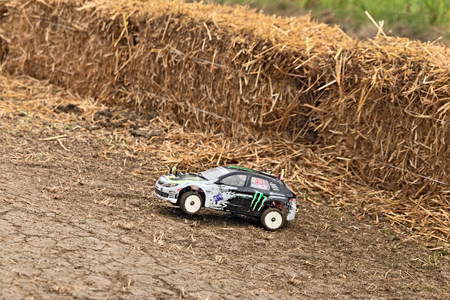radio controlled electric car model, scale 1 10, rally cross race during the country fair  Sagra Paesana Bastia  on April 27, 2014 in Bastia, RA, Italy