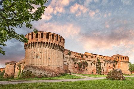 emilia romagna: ancient castle of Imola at sunset, famous old italian fortress - medieval landmark in Emilia Romagna, Italy