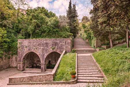 fount: antique Fonte di Docciola in Volterrra, Tuscny, Italy, a fount built in 1254 at the entrance of the town and the staircase that leads to the historic city center