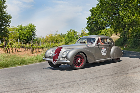 ss: unidentified crew on a vintage sport car Alfa Romeo 6C 2500 SS  1939  runs in historical race Mille Miglia, on May 17, 2014 in Colle di Val d Elsa, SI, Italy Editorial