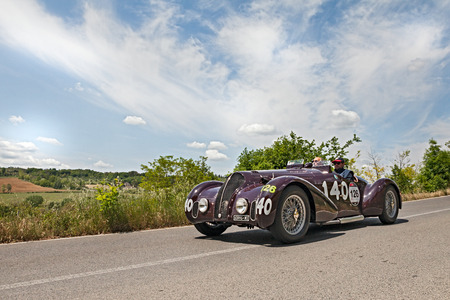 Drivers On A Vintage Sport Car Alfa Romeo 6c 2300 B Mm Spider