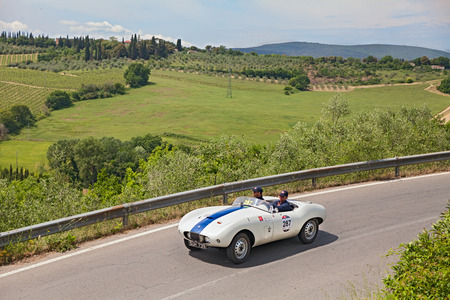 bolide: drivers on a vintage sport car Arnolt Bristol Bolide  1954  runs in the Tuscan country, in historical race Mille Miglia, on May 17, 2014 in Colle di Val d Elsa, SI, Tuscany, Italy