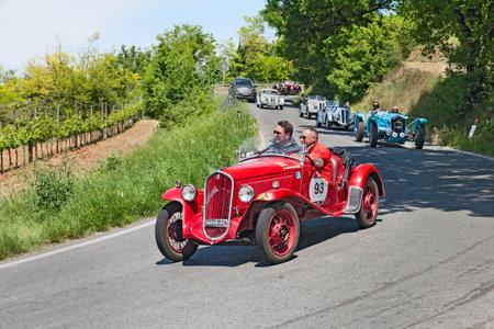 cs: COLLE DI VAL DELSA, SI, ITALY - MAY 17: unidentified crew on a vintage sport car FIAT 508 CS Coppa dOro Balilla Sport (1934) runs in historical rally Mille Miglia, on May 17, 2014 in Colle di Val dElsa, Tuscany, Italy