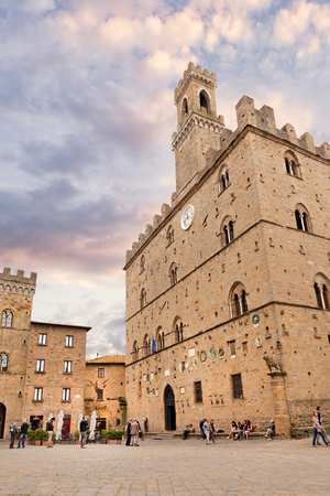 priori: the ancient Priori square with the Palazzo dei Priori, the oldest town hall in Tuscany, on May 16, 2014 in the medieval city of Volterra, Italy Editorial