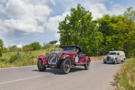 ss: drivers on a vintage sport car O M  665 SS MM Superba  1930  runs in historical rally Mille Miglia, on May 17, 2014 in Colle di Val d Elsa, Tuscany, Italy