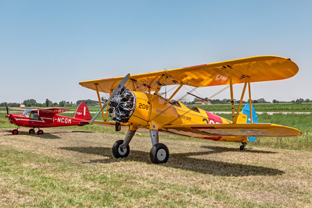 old biplane aircraft Boeing Stearman Model 75 N2S-1 1941 exposed at festival Belle Epoque of Aero Club Lugo on June 7, 2014 in Lugo, RA, Italy
