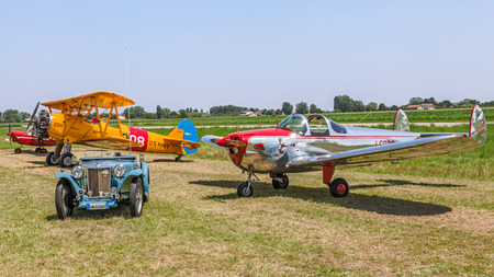 vintage car and airplanes exposed at festival  Belle Epoque  of Aero Club Lugo; MG TC Spider  1948 , Boeing Stearman Model 75, Erco Ercoupe 415D, Aermacchi MB 308, on June 7, 2014 in Lugo, RA, Italy