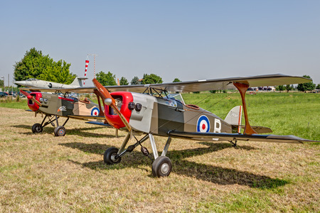 couple of Boredom Fighter, biplane designed to be similar to a wartime SPAD fighter of the First World War, exposed at festival  Belle Epoque  of Aero Club Lugo on June 7, 2014 in Lugo, RA, Italy