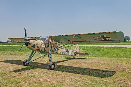 monoplane: old German airplane Fieseler Fi-156 Storch  reproduction  exposed at festival  Belle Epoque  of Aero Club Lugo on June 7, 2014 in Lugo, RA, Italy