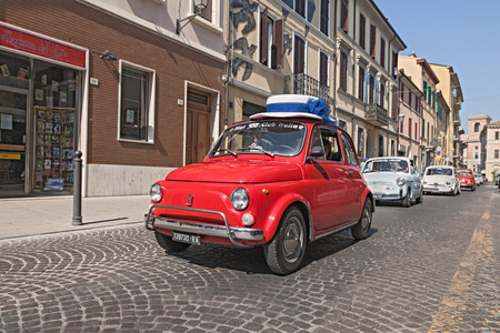 a qoman drive a red vintage Fiat 500 with a funny hat, lead a line of the classic italian mini car during the rally  Emozioni 500   on June 8, 2014 in Forli , Italy