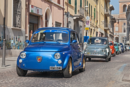 a blue vintage Fiat 500 Abarth leads a line of italian mini cars during the rally  Emozioni 500   on June 8, 2014 in Forli , Italy