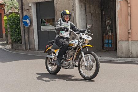 scrambler: the biker Nigel Wanless rides a vintage italian motorcycle Ducati RT 450 during the historic rally  Motogiro d Italia  1914 - 2014   on June 6, 2014 in Forli , Italy