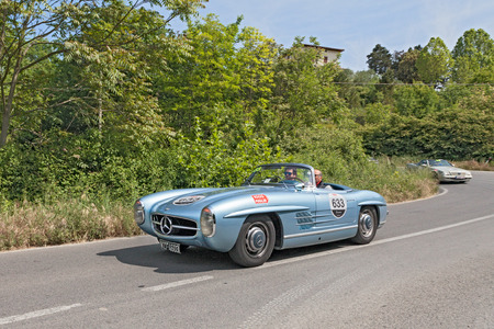 tribute: the crew Marco and Paolo Cefis on a vintage car Mercedes Benz spyder  1955  in Mercedes tribute to Mille Miglia, on May 17, 2014 in Colle di Val d Elsa, Tuscany, Italy