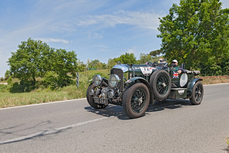 litre: the crew Ford - Pike on a vintage racing car Bentley 4 5 Litre S C   1930  runs in historical race Mille Miglia, on May 17, 2014 in Colle di Val d Elsa, Tuscany, Italy Editorial