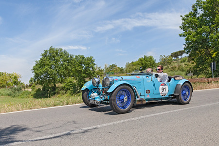 the crew Jan and Karel Ten Cate on a vintage racing car Aston Martin  Le Mans  1933  runs in historical race Mille Miglia, on May 17, 2014 in Colle di Val d Elsa, Tuscany, Italy