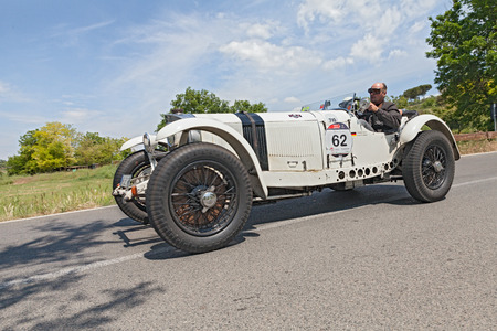 the crew Kern - Abaci on a racing car Mercedes-Benz 720 SSKL  1930  in historical rally Mille Miglia, on May 17, 2014 in Colle di Val d Elsa, Tuscany, Italy