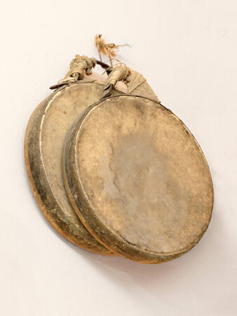 play popular: ancient traditional italian tambourines, made from wood and goat skin - frame drum used to play popular dance in Italy