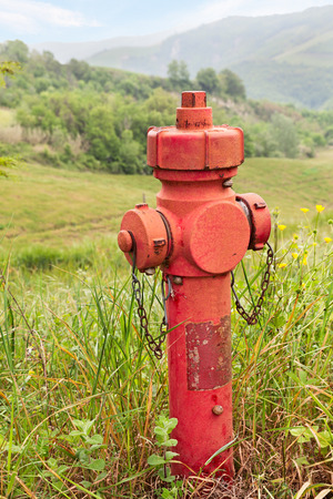 bushfire: red emergency hydrant in the mountains for water supply in case of the bushfire Stock Photo