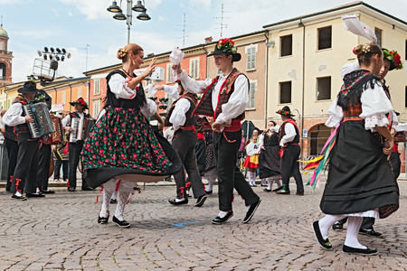 ensemble: the folk dance ensemble  Gruppo Federico Angelica  from Pordenone, Friuli Venezia Giulia, Italy, performs traditional dance during the International Folklore Festival of Russi, on August 3, 2014 in Russi, RA, Italy