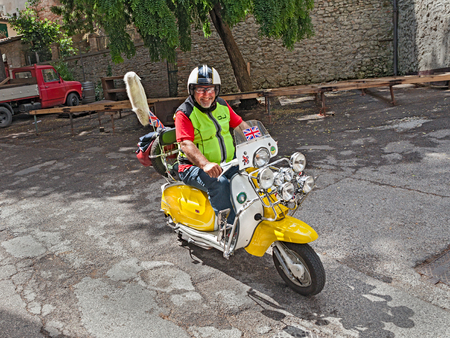 tuned: biker riding a tuned vintage scooter Lambretta during the italian scooters rally  Innocenti Day  of Lambretta club Umbria, on June 14, 2014 in Bertinoro  FC  Italy  Editorial