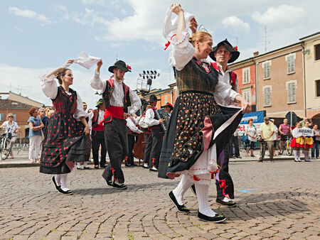 twirled: RUSSI, RA, ITALY - AUGUST 3: the folk dance ensemble Gruppo Federico Angelica from Pordenone, Friuli Venezia Giulia, Italy, performs traditional dance during the International Folklore Festival of Russi, on August 3, 2014 in Russi, RA, Italy