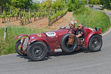 romeo: the crew Frans and Renee Van Haren on ancient racing car Alfa Romeo 8C 2900 A  1936  travel in Tuscany during the historical race Mille Miglia, on May 17, 2014 in Colle di Val d Elsa, SI, Tuscany, Italy