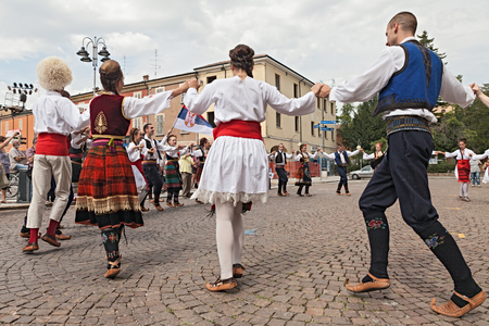the folk dance group Folklore ensemble Saint George s Church from Belgrade, Serbia, performs popular circle dances in traditional dress at the International Folklore Festival of Russi, on August 3, 2014 in Russi, RA, Italy